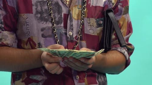 Man Holding Stack Of Money