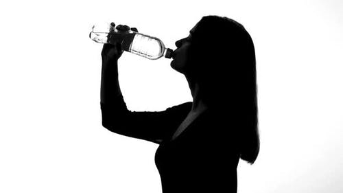 Woman Drinking Water From Bottle, Healthy Way of Life, Restoring Ph Balance