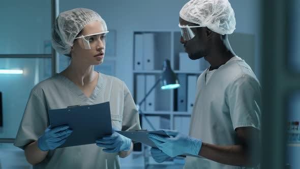 Multiethnic Colleagues Speaking in Laboratory