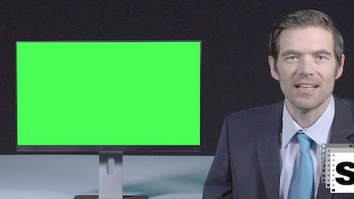 Male Presenter With Green Screen