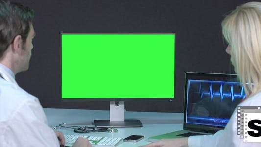 Thumbnail for Doctors Looking At Green Screen