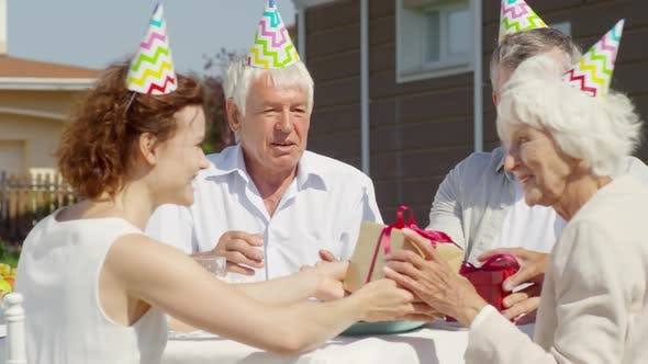 Thumbnail for Family Giving Presents and Applauding Grandmother on Birthday Party