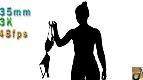 Silhouette Of Young Woman Undressing