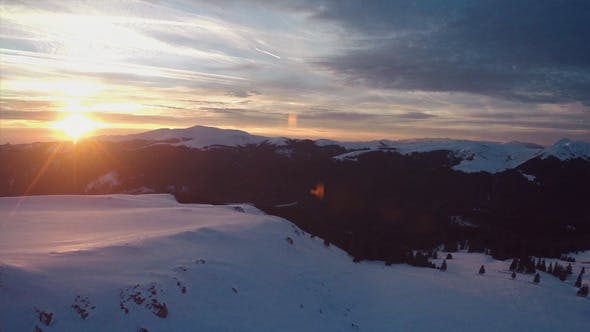 Thumbnail for Winter Sunset - Flying Above the Mountains