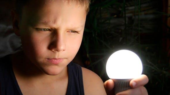 Thumbnail for Boy Holds In Hand Light Bulb