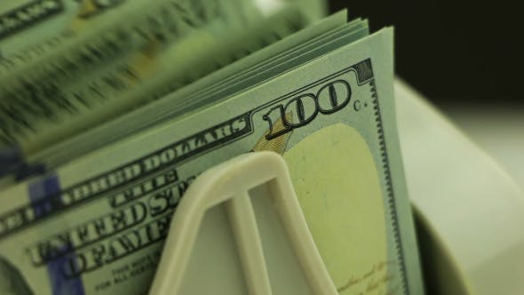 Thumbnail for Money Counters and 100-USD Banknotes