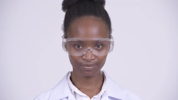 Thumbnail for Face of Young Beautiful African Woman Doctor Wearing Protective Glasses
