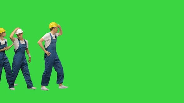 Thumbnail for Three Young Construction Workers Doing a Funny Row Dance Touching Their Hardhats and Pointing