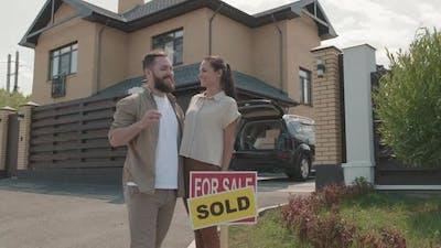 Happy New Homeowners Posing