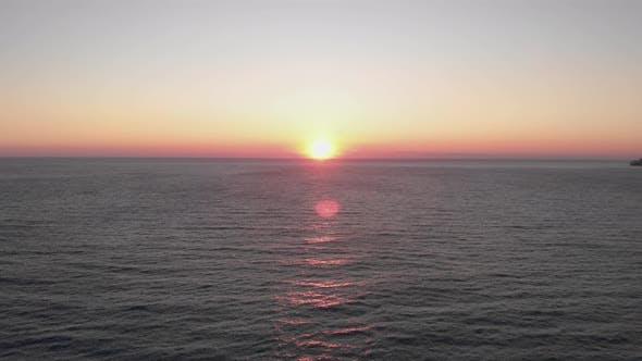 Amazing pink sea sunset. Summer tropical sundown over ocea