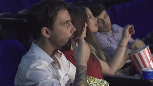 The Four Fellow Are Sitting at the Premiere of the Film at the Cinema