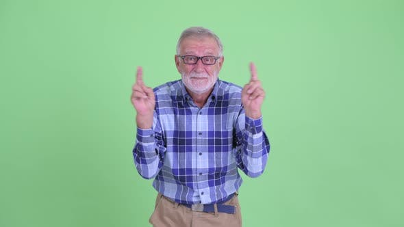 Thumbnail for Senior Bearded Hipster Man Wishing with Fingers Crossed