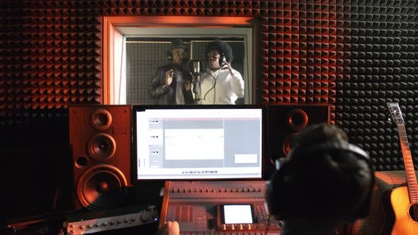 Thumbnail for Singers Recording Song in Studio