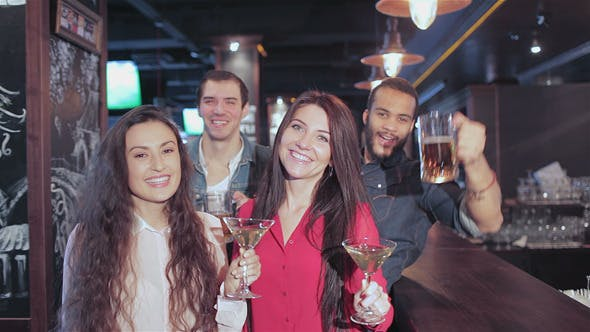 Thumbnail for Cheerful Company In The Bar With Glasses