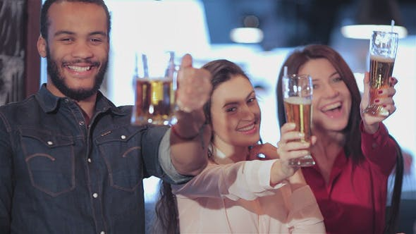 Thumbnail for Young Company Lifts Up A Glass Of Beer