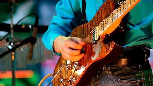 Thumbnail for Man Playing Guitar