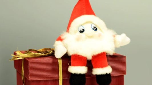 Thumbnail for Christmas Gnome Jumping on a Holiday Present