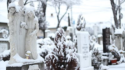 Snowing on Cemetery