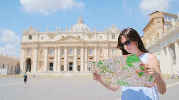 Thumbnail for Happy Young Woman with City Map in Vatican City and St. Peter's Basilica Church