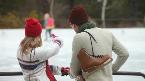 Couple together by ice skating rink
