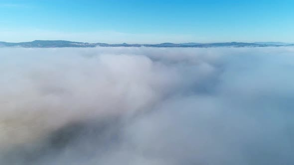 Thumbnail for Aerial Drone View Above the Clouds and Covered Mountains in the Winter