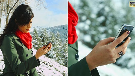 Cover Image for Woman Texting With Her Phone in Winter Scenery