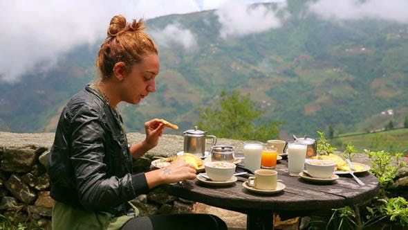 Thumbnail for Tourist Woman Eating Breakfast Himalayan Mountain