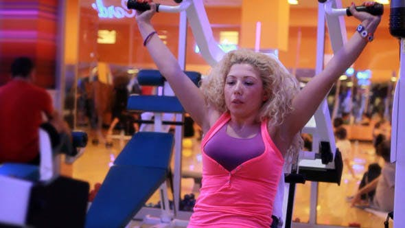 Girl Doing Sports In A Gym, Fitness Center 17