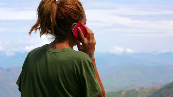 Thumbnail for Female Tourist Using Mobile Phone at Mountain 2