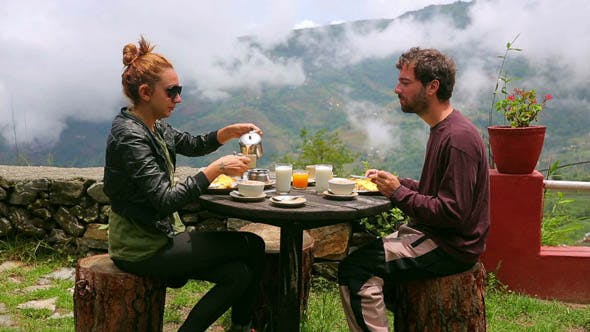 Thumbnail for Tourist Couple Eating Breakfast Himalayan Mountain
