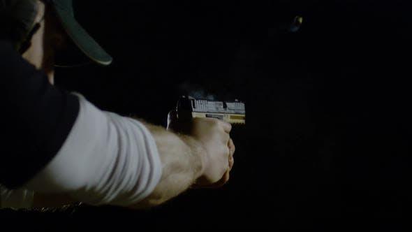 Thumbnail for Gun firing two bullets, Ultra Slow Motion