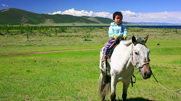 Thumbnail for Young Baby Girl On Horseback In Steppe