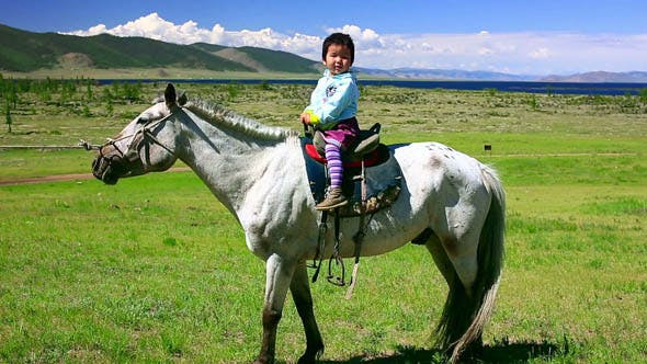 Thumbnail for Young Baby Girl On Horseback In Steppe 2