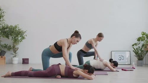 Women Stretching Their Backs during Stretching Classes