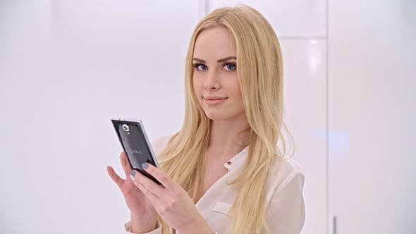 Thumbnail for Young Blond Girl Using Mobile Phone