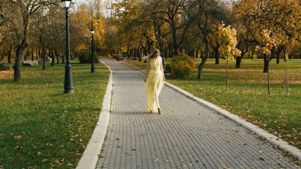 Thumbnail for Blonde Woman Walking In The Park