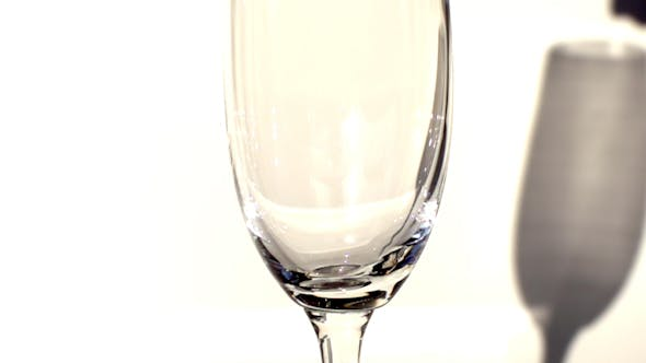 Thumbnail for Champagne Being Poured Into A Tall Glass