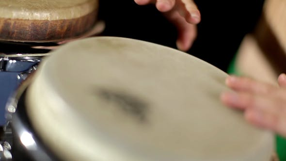 Thumbnail for Female Percussion Drummer Performing With Bongos 19