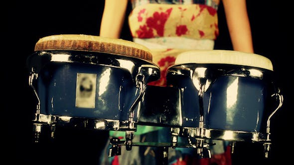 Cover Image for Female Percussion Drummer Performing With Bongos 5
