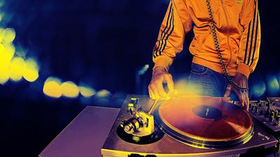 Male Dj Behind The Turntables 4