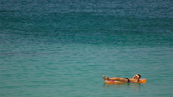 Thumbnail for Sunbathes in Ocean