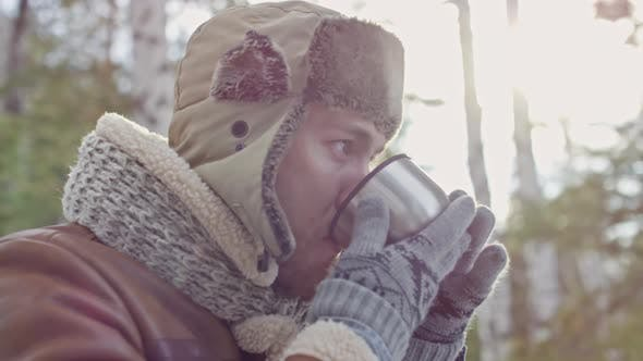 Thumbnail for Man Relaxing with Tea in Forest