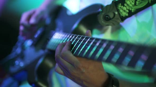 Thumbnail for Guitarist Playing Electric Guitar at Concert