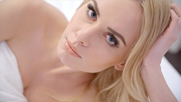 Thumbnail for Beautiful Blonde Girl Lying on Bed