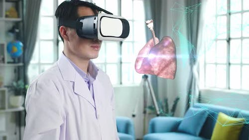 Male Doctor Using Vr Glasses Virtual Reality Touching 3D Human Lung Holographic