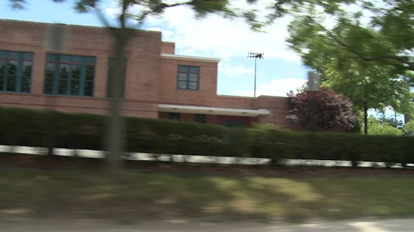 Thumbnail for Driving Passed Brick Building