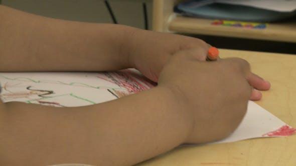 Grammar School Child Using A Crayon (1 Of 5)