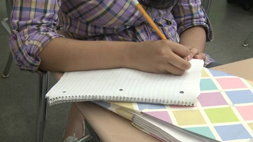 Junior High Students Writing In Class (5 Of 6)