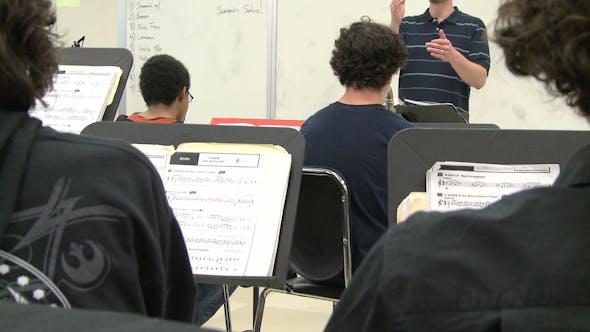 Music Teacher Instructing Class