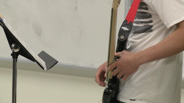 Thumbnail for Student Playing Guitar In Music Class